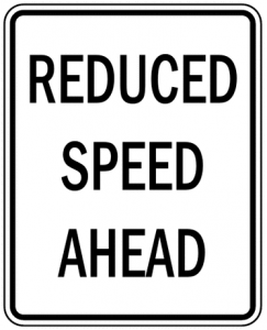 Fun Activities for Kids on Road Trips - Reduced Speed sign